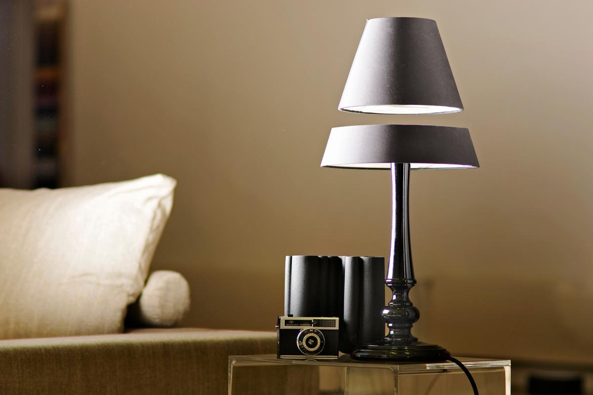 The Silhouette Lamp combines classic looks with electromagnetic technology to produce a table lamp with a floating top
