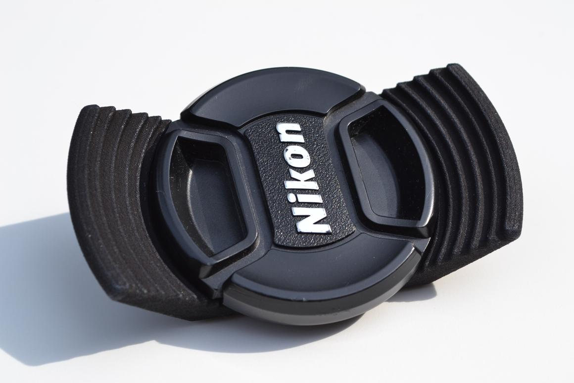The Stow-Away lens cap holder attaches under your camera and gives you somewhere to stow your lens cap