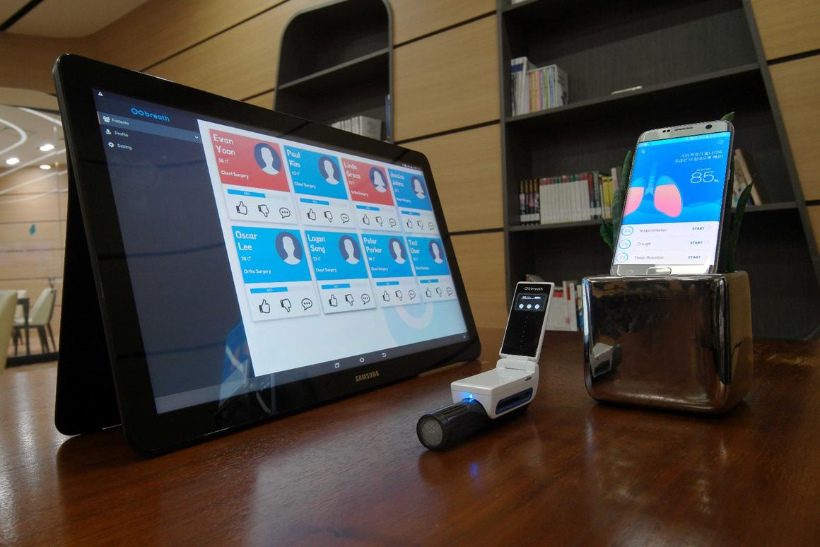 The GoBreath device (middle) wirelessly transmits data to the cloud