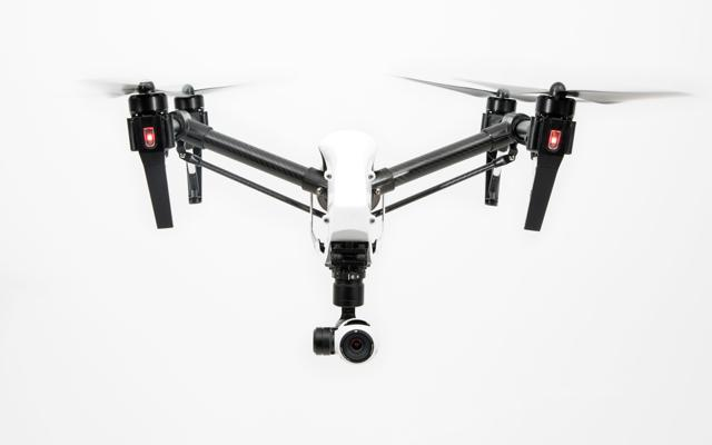 The DJI Inspire 1, with its landing gear and prop arms raised for flight