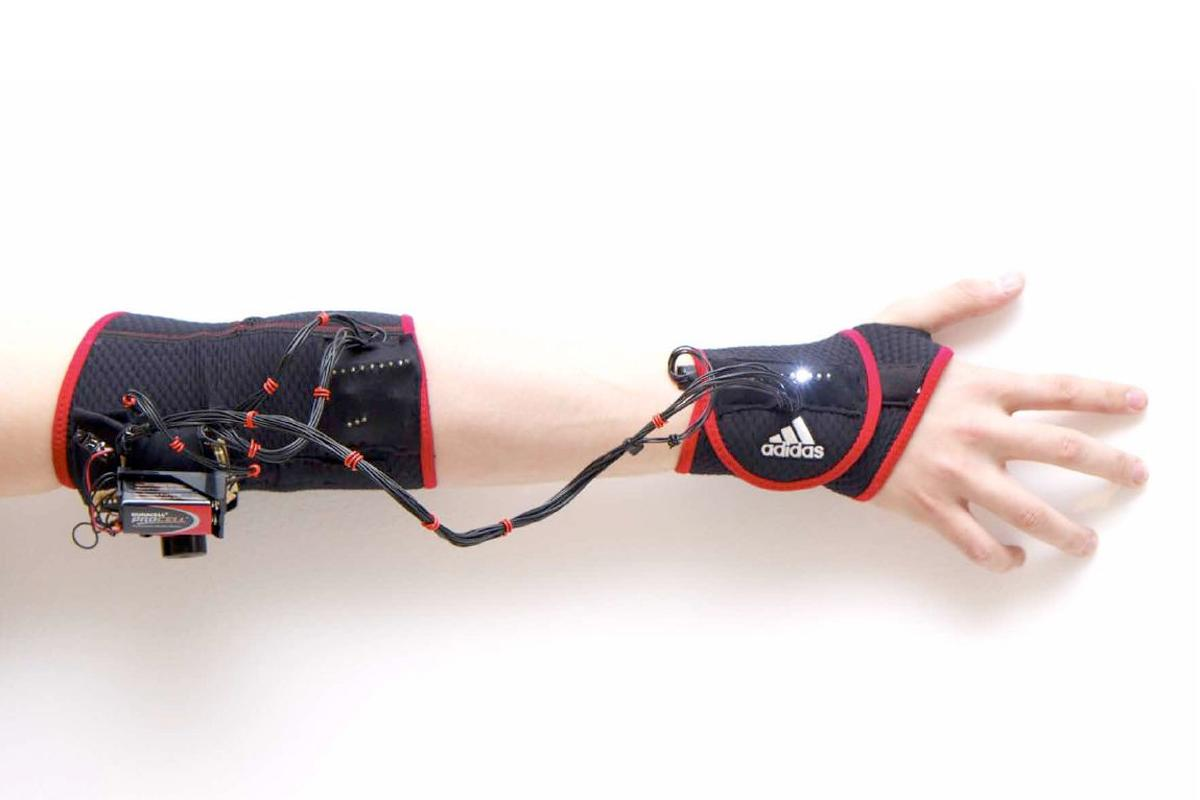 Ghost is a prototype vibrating armband, designed to help athletes with muscle memory