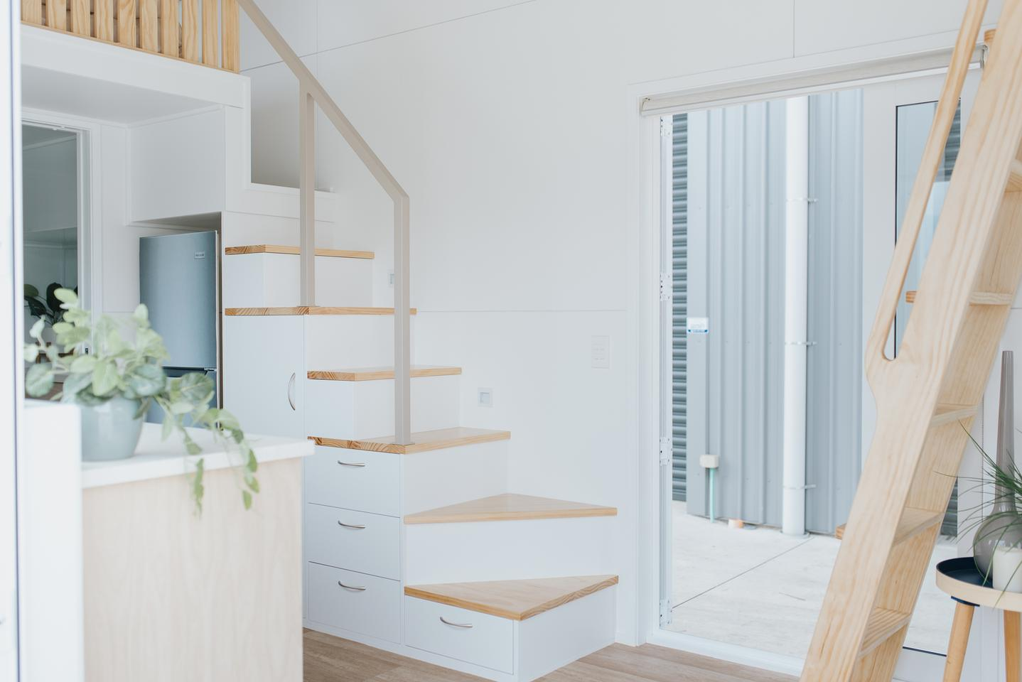 The Bay Tree Tiny House features a storage-integrated staircase