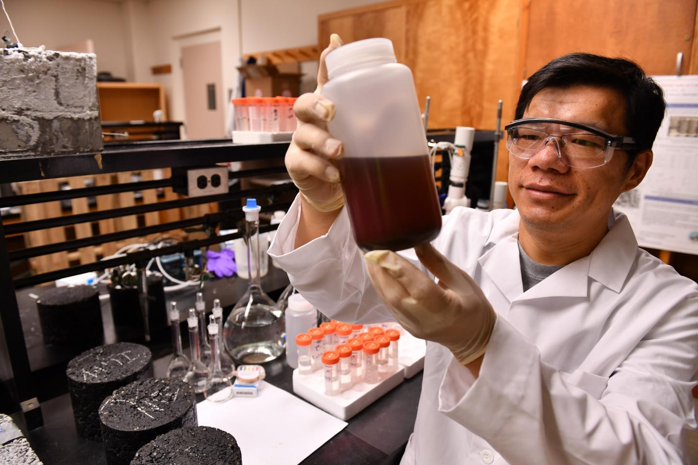 Assoc. Prof. Xianming Shi, with a container of grape-skin extract
