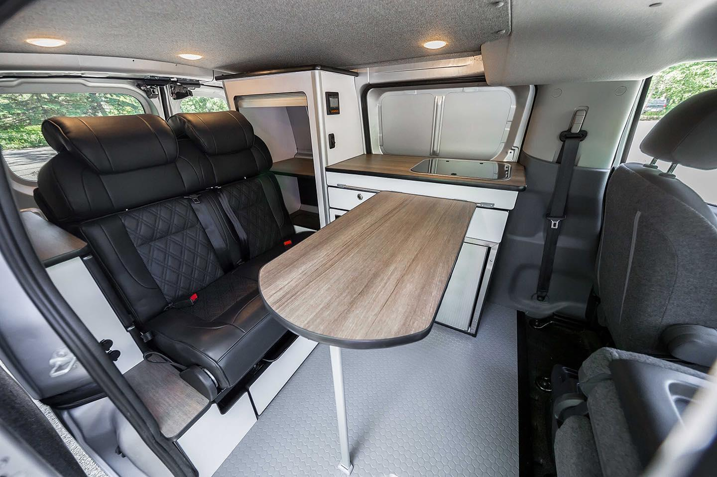 The removable table creates a dining area in the center of the van