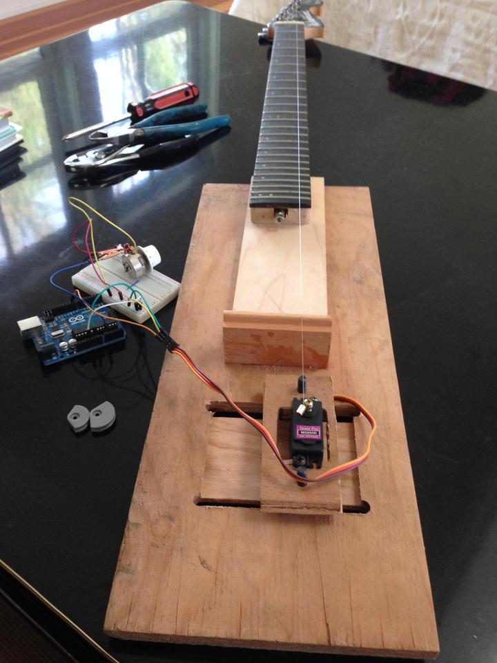 The first test model, with a single string, analog servo, Arduino and breadboard