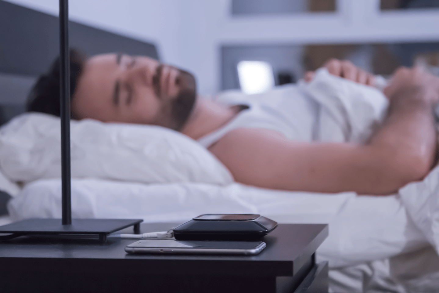 A fiber-optics band fits under a mattress and tracks metrics such as heartbeat, breathing and room temperature through the night