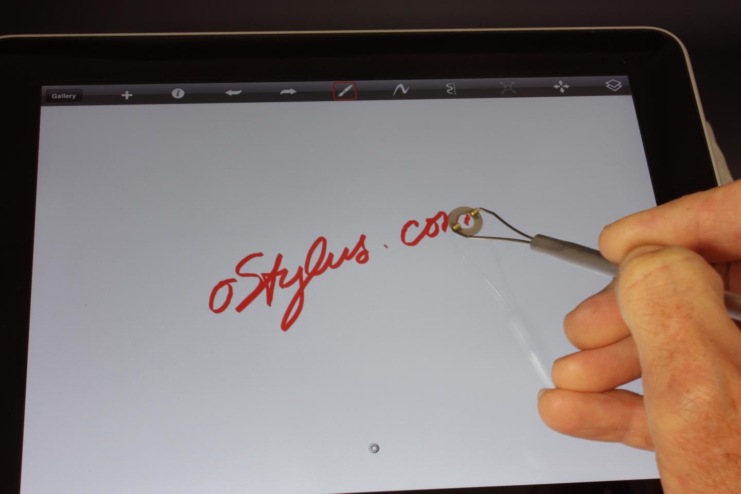 A pre-production prototype writing on the touchscreen display of an iPad