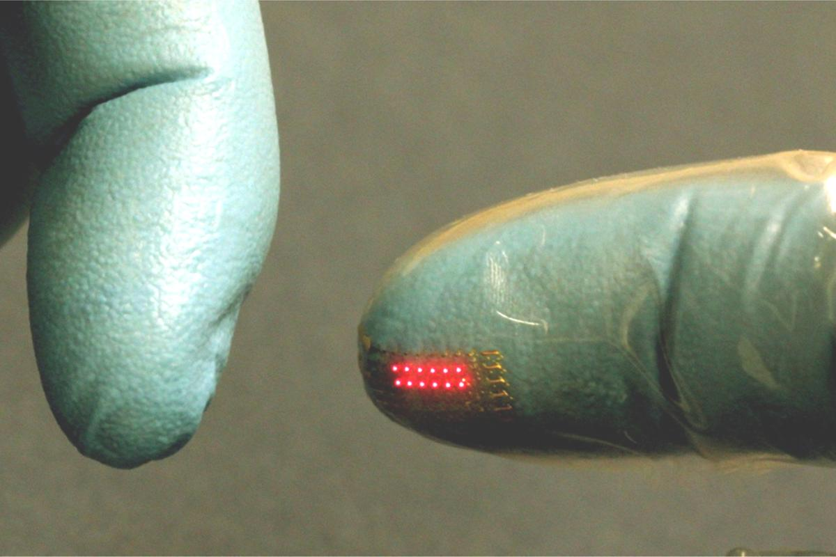 An LED array, transfer printed onto the fingertip of a vinyl glove