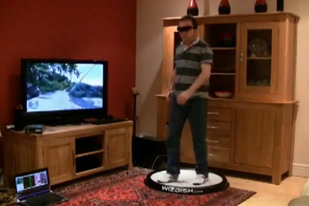 WizDish in action: in front of a television set accommodating a gamer wearing a VR headset