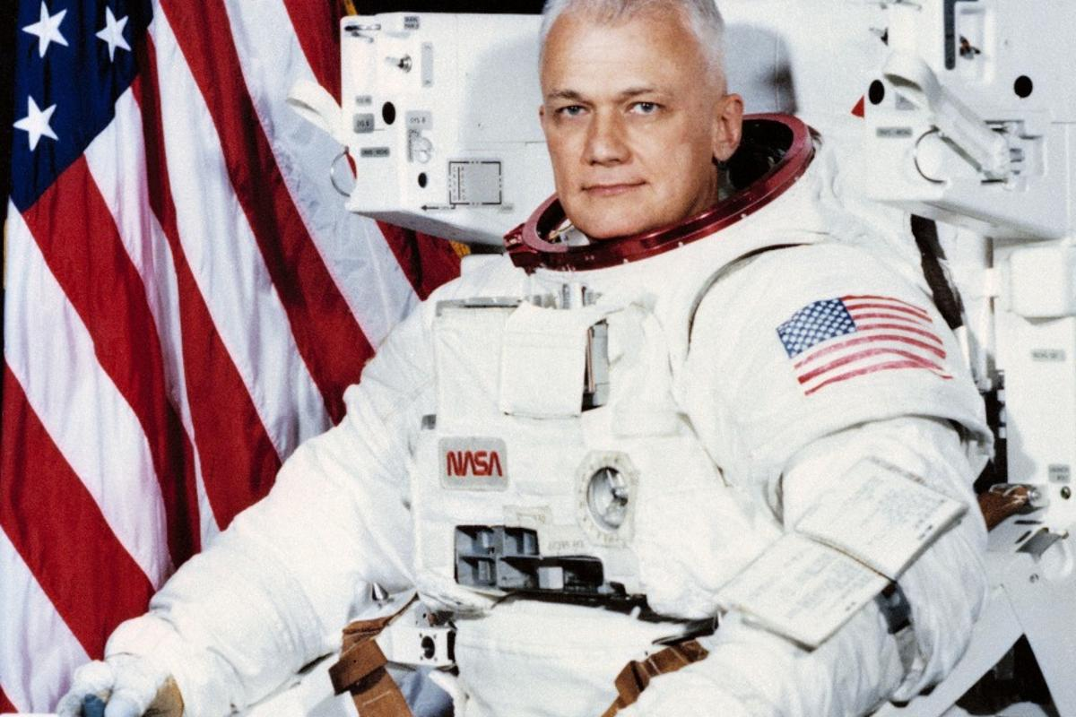 Official Space Shuttle portrait showing Astronaut Bruce McCandless II, attired in the Shuttle Extravehicular Activity (EVA) Suit with Manned Maneuvering Unit (MMU) attached