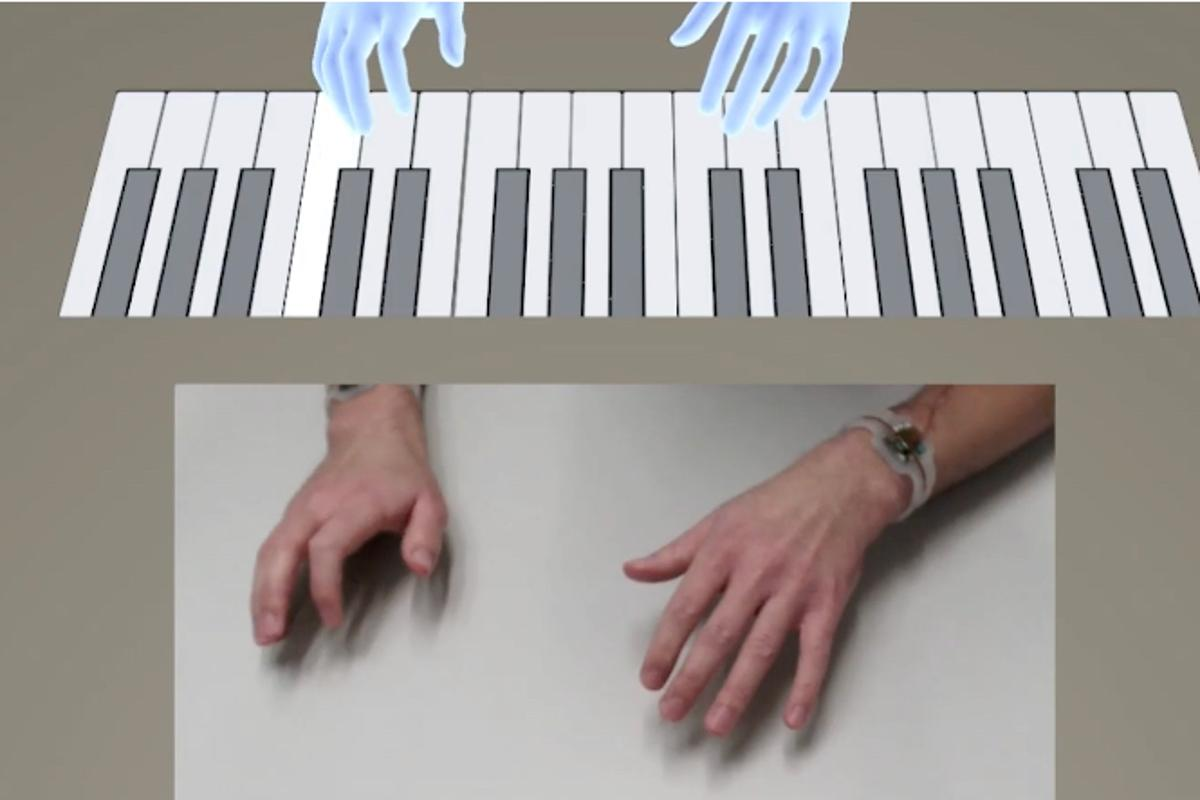 A user wearing dual TapID wristbands is able to play a virtual piano