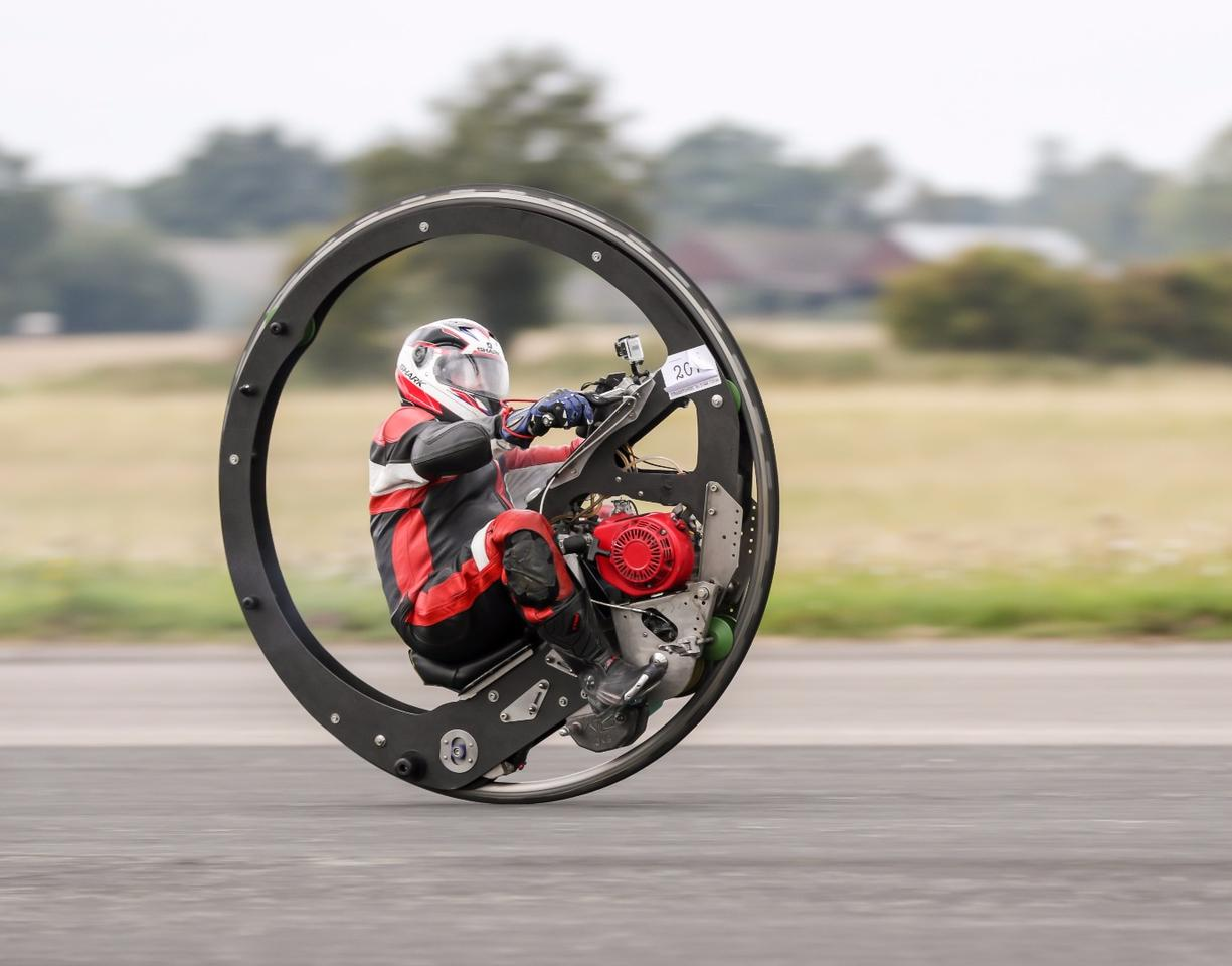 Kevin Scott, of Lincoln, sets the world's fastest monowheel record at 61.18 mph