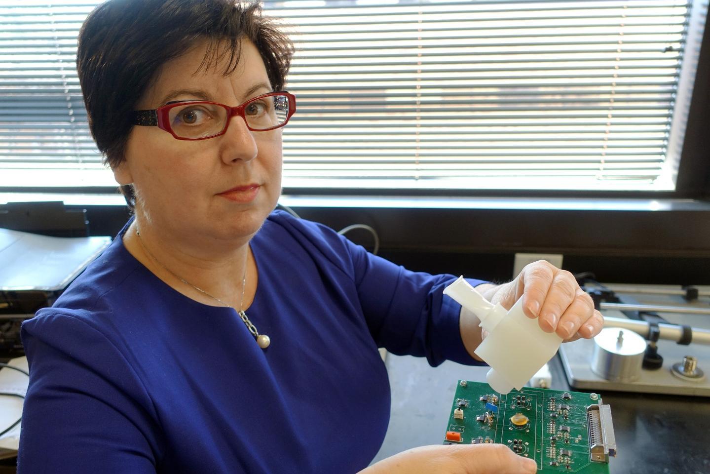 Prof. Perena Gouma with her prototype flu detector