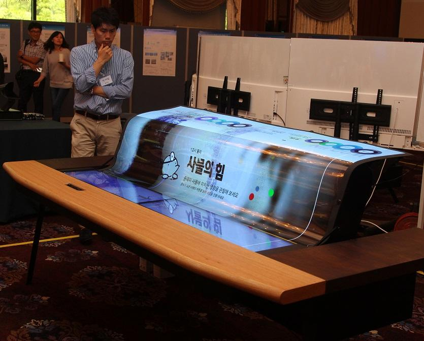 A 77-inch flexible screen for your smart desk, sir?