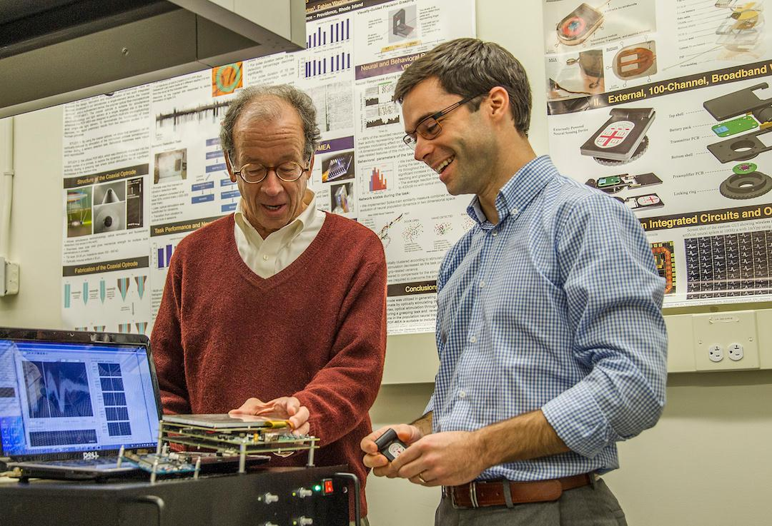 Brown engineering professor Arto Nurmikko (left) with David Borton (right), who helped to develop the wireless neurosensor technology