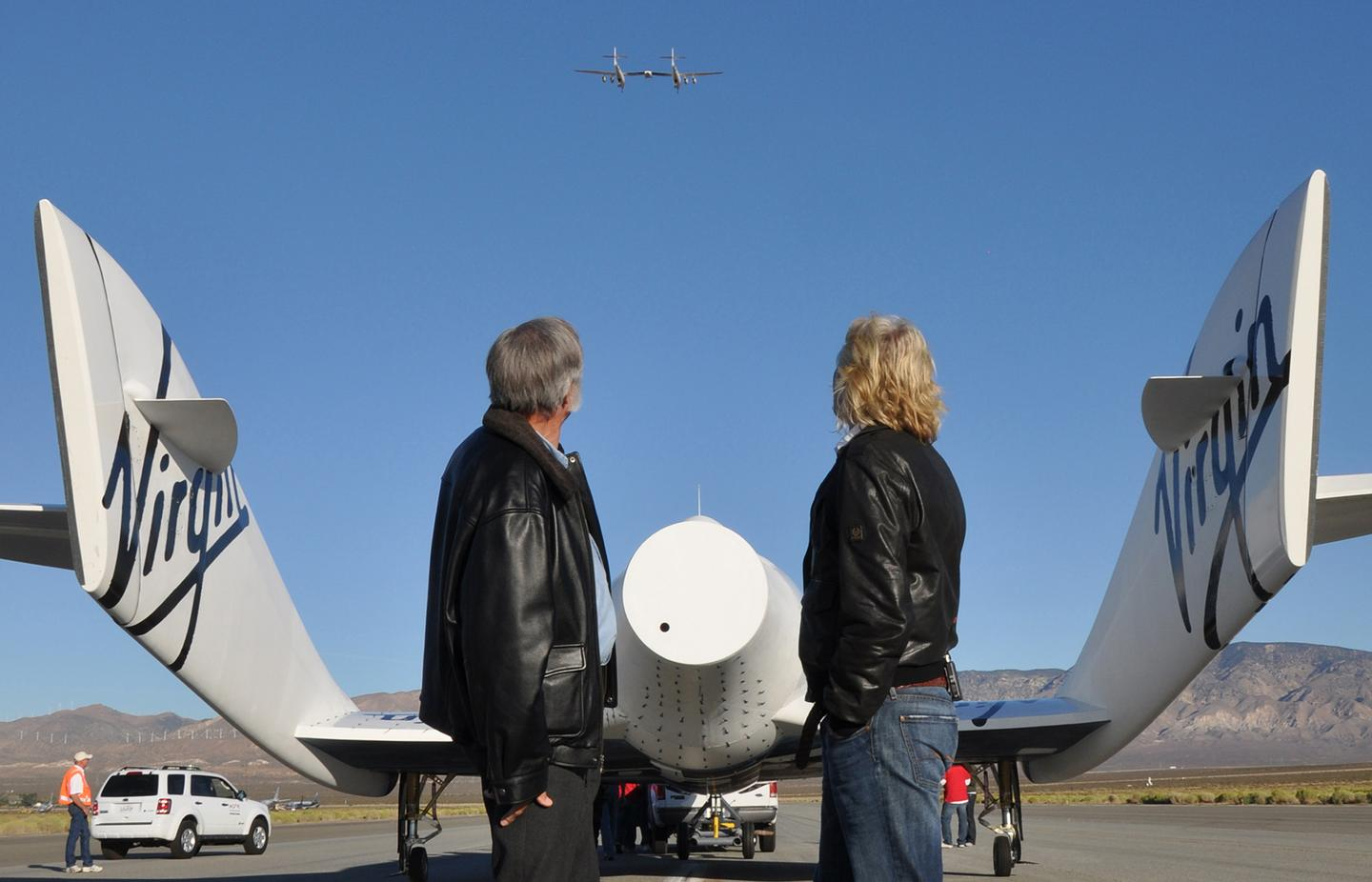 Sir Richard Branson and Burt Rutan with VSS Enterprise as VMS Eve flies above (Image: Mike Mills)