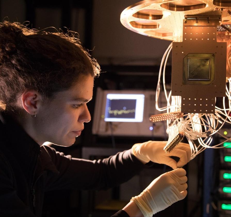 Research Scientist Marissa Giustina installs a Bristlecone chip