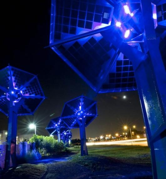 The installation lights up the walkway by night via LED stamens on each sunflower