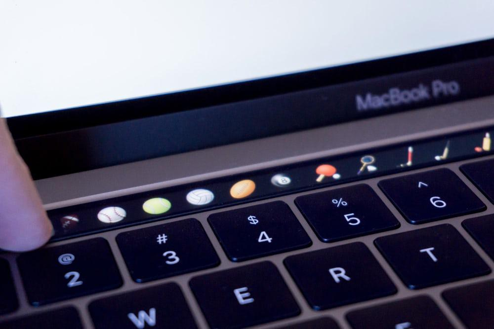 The MacBook Pro Touch Bar, populated with emojis