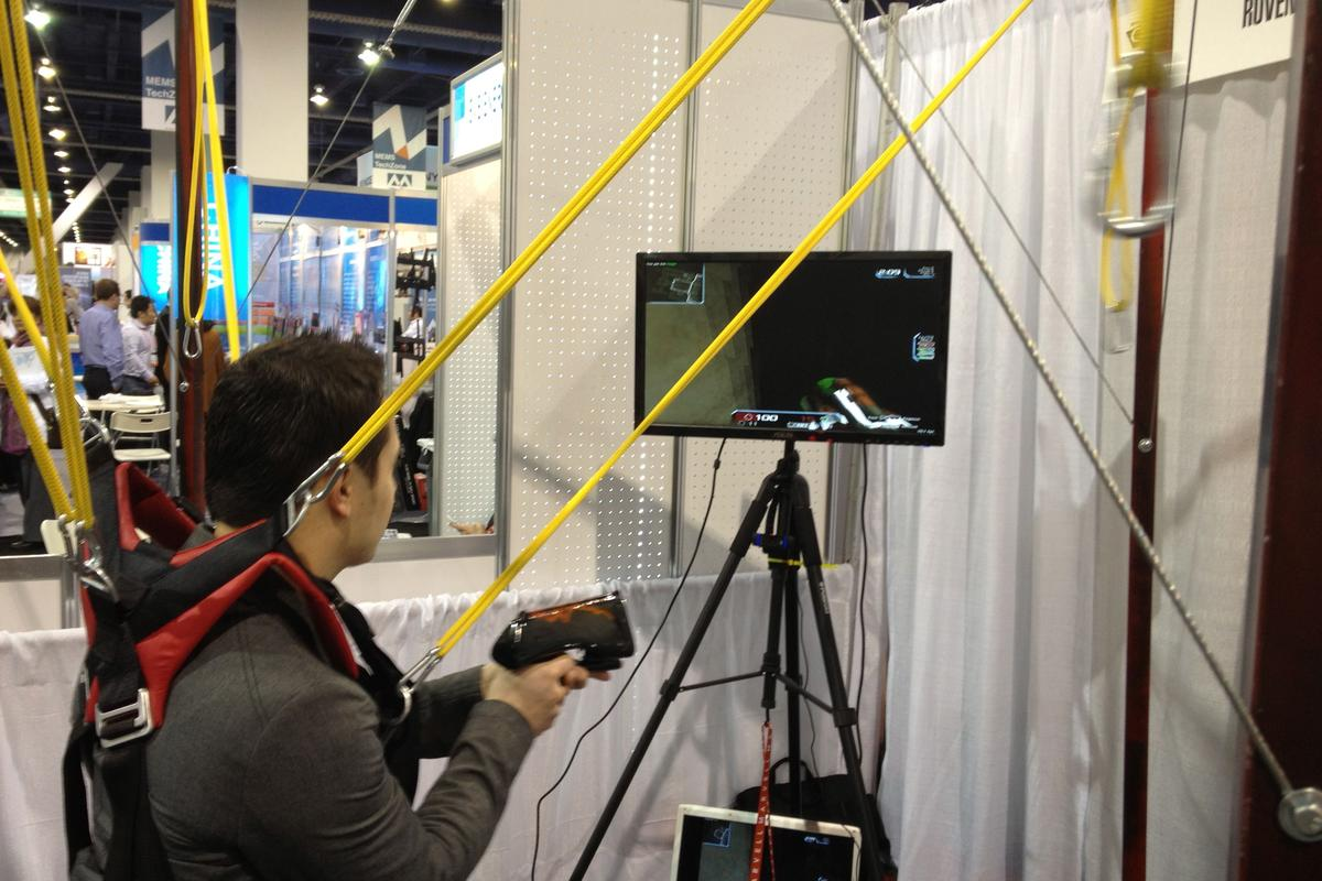 Intellect Motion's GameCube and IM Gun, in use at CES