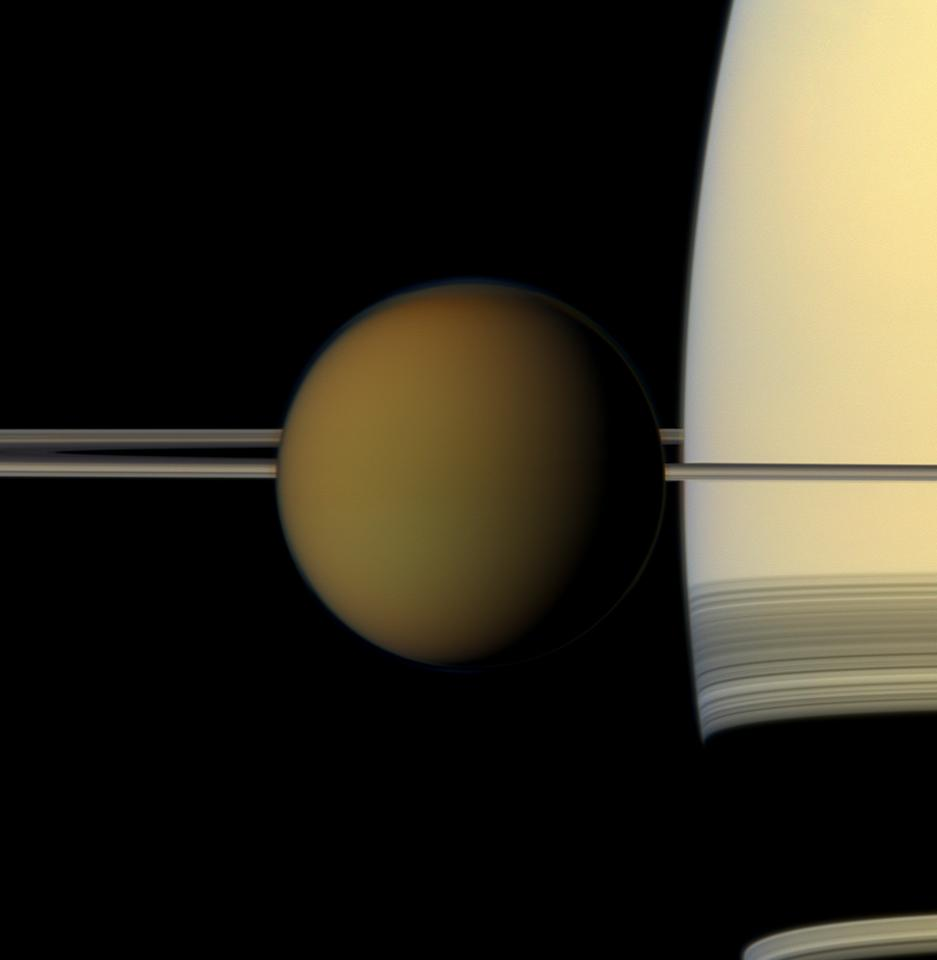 Titan is seen passing in front of its home planet, Saturn, in this natural-color image from the Cassini spacecraft taken in 2011 at a distance of about1.4 million miles (2.3 million kilometers) from the moon