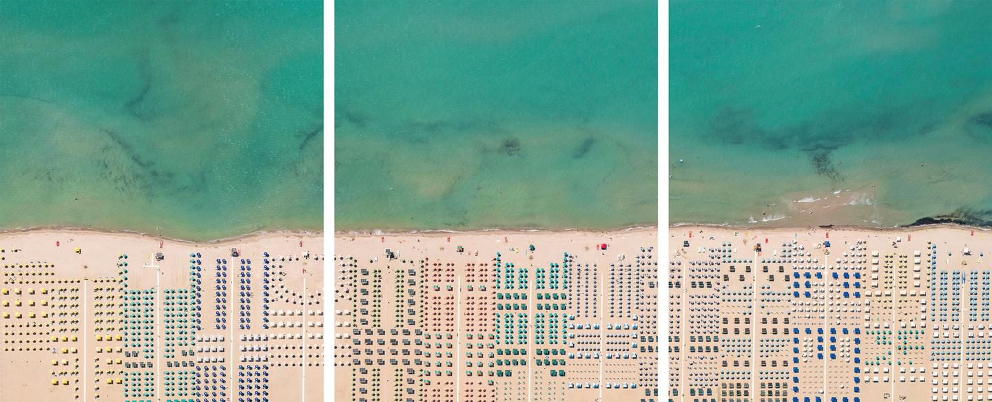 One of Lang's personal favorite photographs, a triptych of beach umbrellas in Versilia, Tuscany