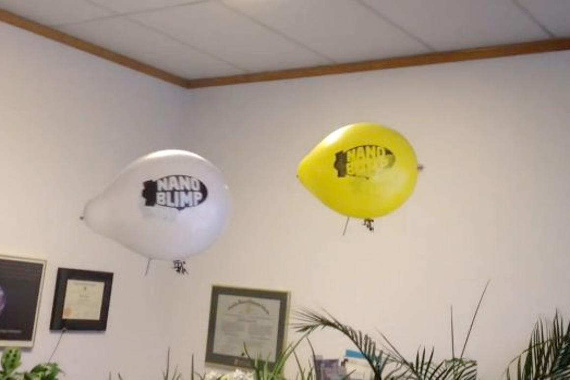 Two Nanoblimps, engaging in aerial warfare in an office