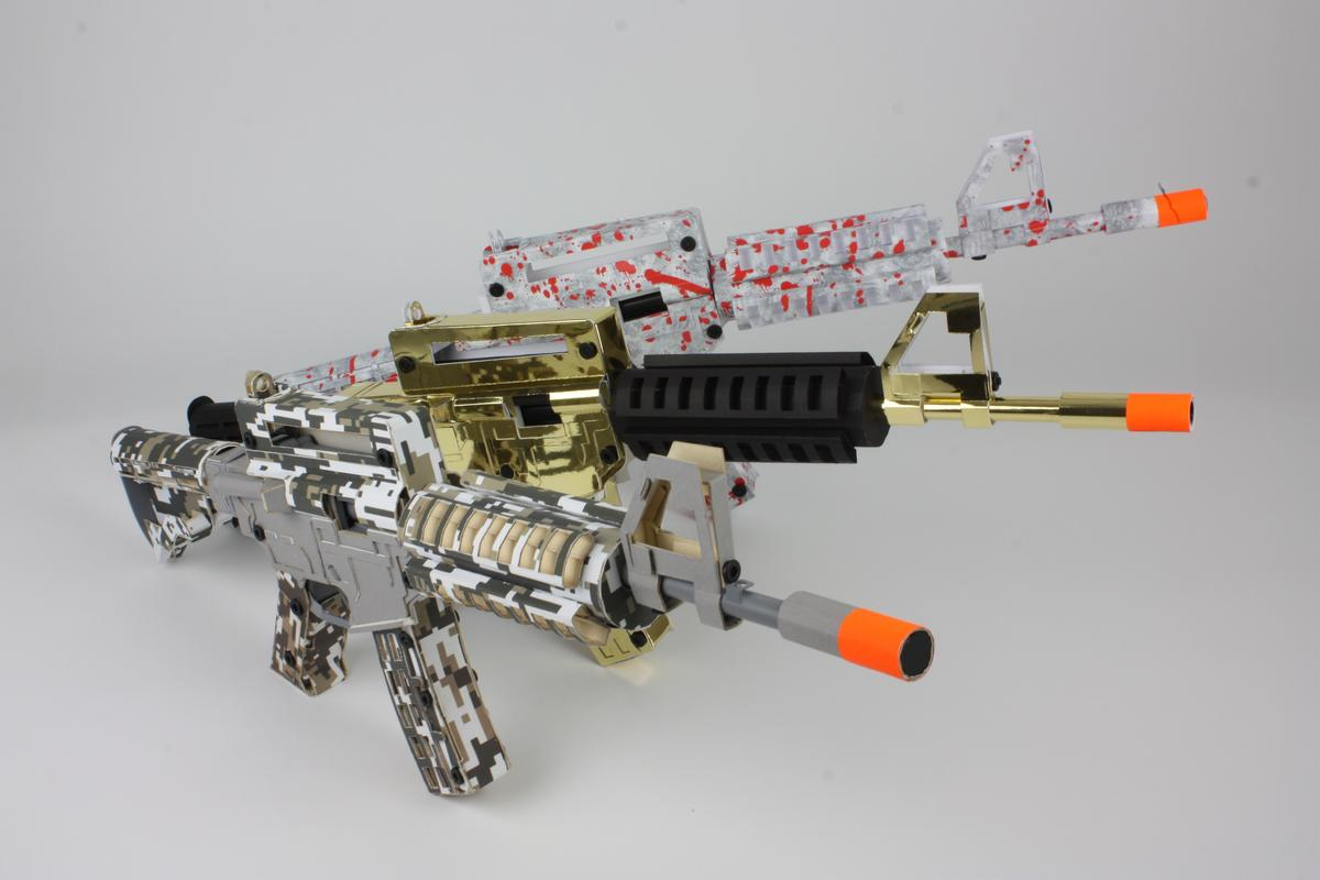 """The cardboard rifles are available in three iterations: """"Digital Ops,"""" """"Zombie Slayer,"""" and """"Golden Touch"""""""