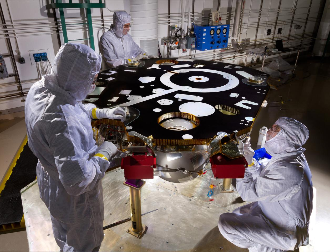 Technicians at Lockheed Martin prepare the InSight Mars lander for propulsion proof and leak testing