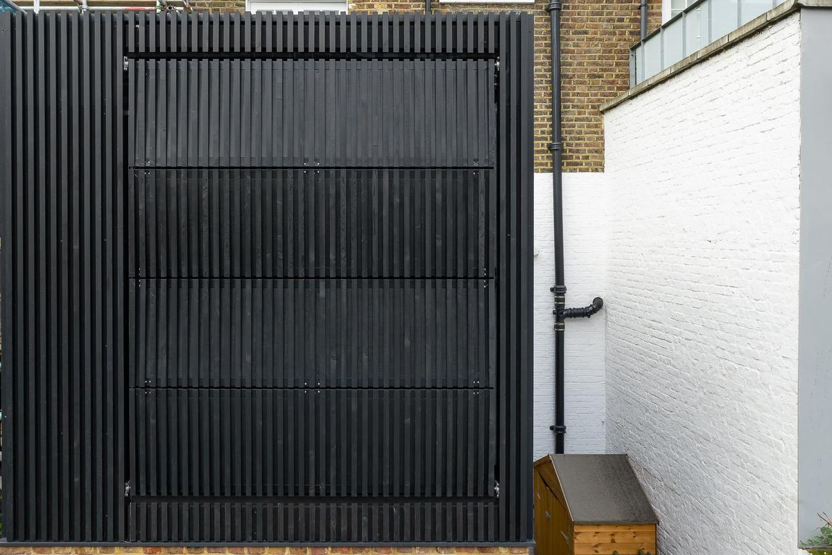 Black Box's shutters are clad in dark stained Siberian Larch