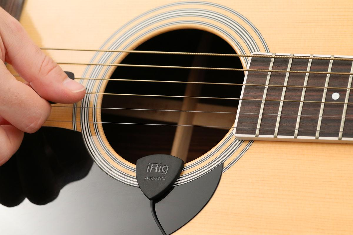 The iRig Acoustic clamps to the soundhole of an acoustic guitar or ukulele