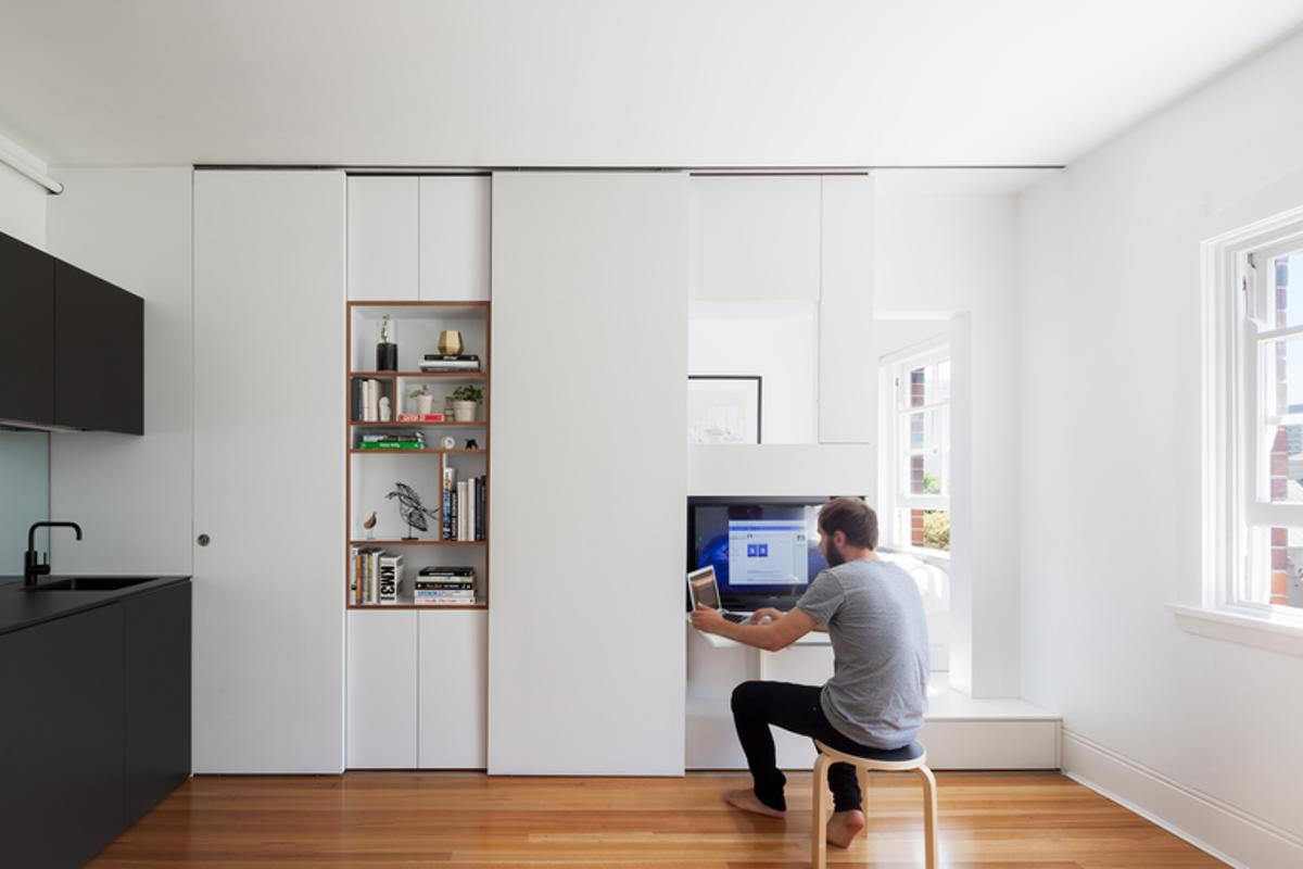 The 27-square meter (290-sq ft) apartment was transformed into a multi-functional home that comfortably accommodates two