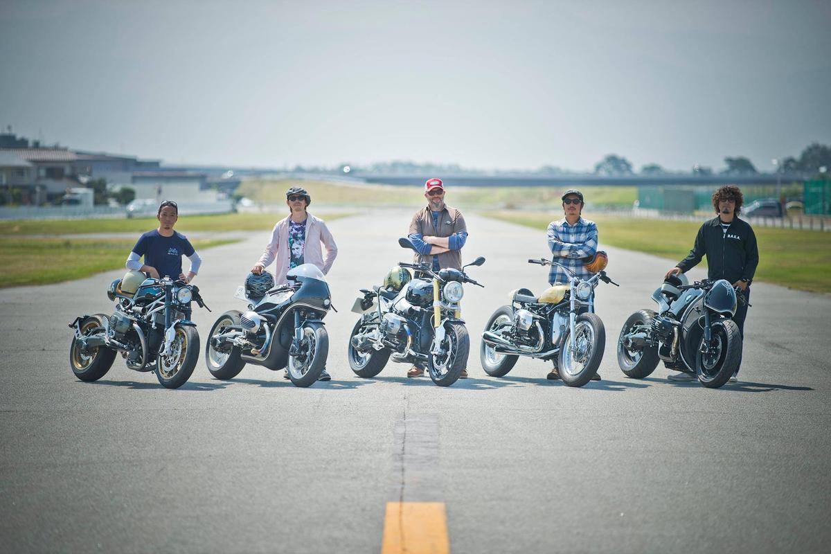 The four project nineT custom designers with their creations - and BMW Head of Vehicle Design Ole Stenegard in the centre with the standard R nineT
