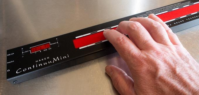 The ContinuuMini's red playing surface can translate movement from one or two fingers into expressive sounds