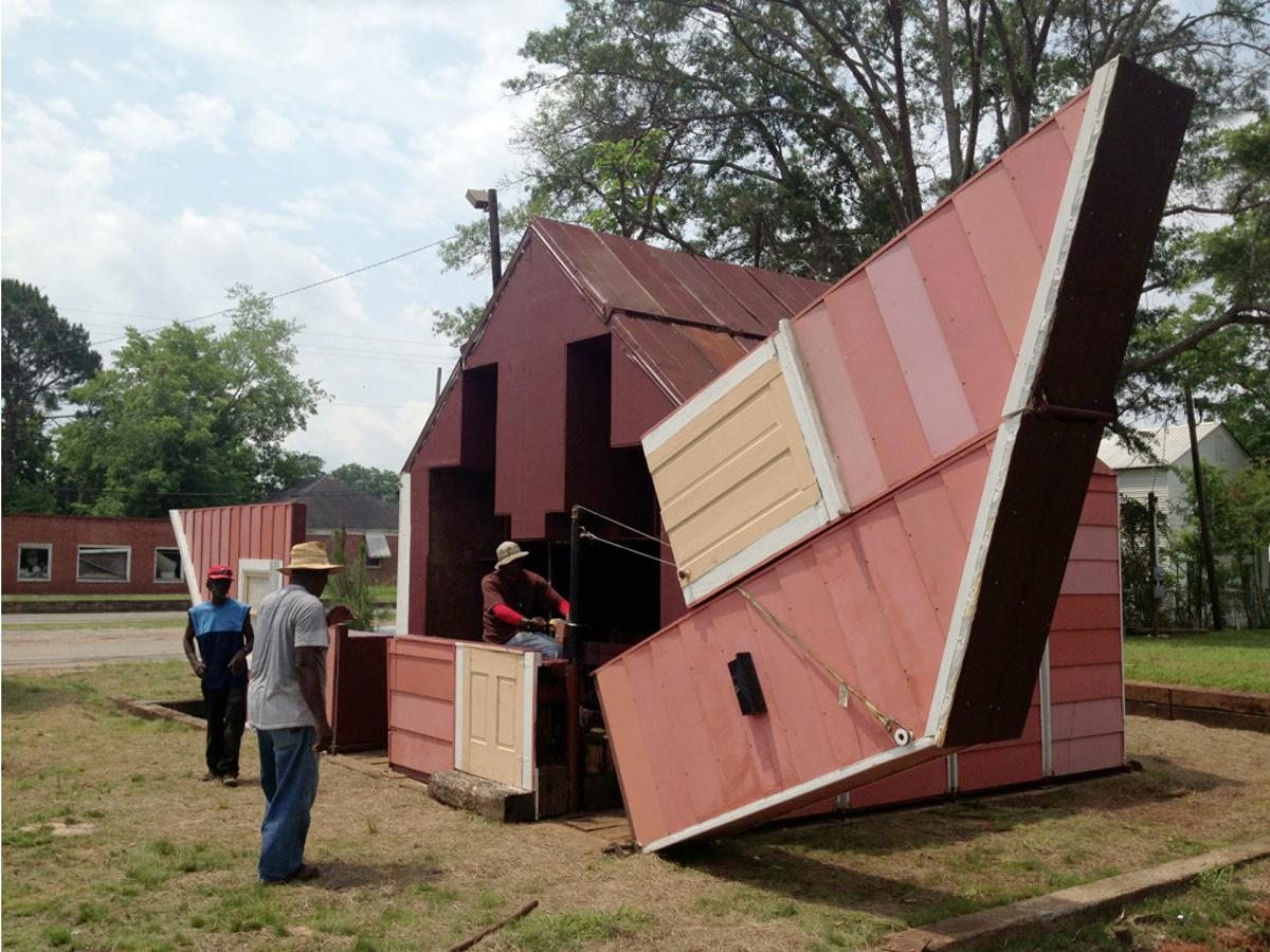 Open House by artist Matthew Mazzotta may look like a simple wooden home, but it actually folds open to create a unique outdoor theater