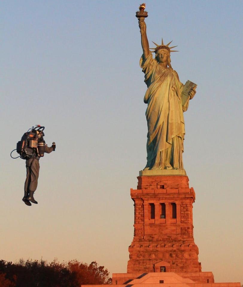 David Mayman flies around the Statue of Liberty