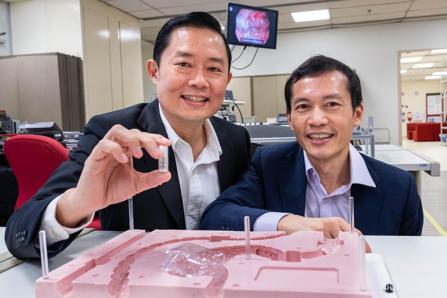 Prof. Louis Phee (left)and Prof. Lawrence Ho, with the prototype EndoPil