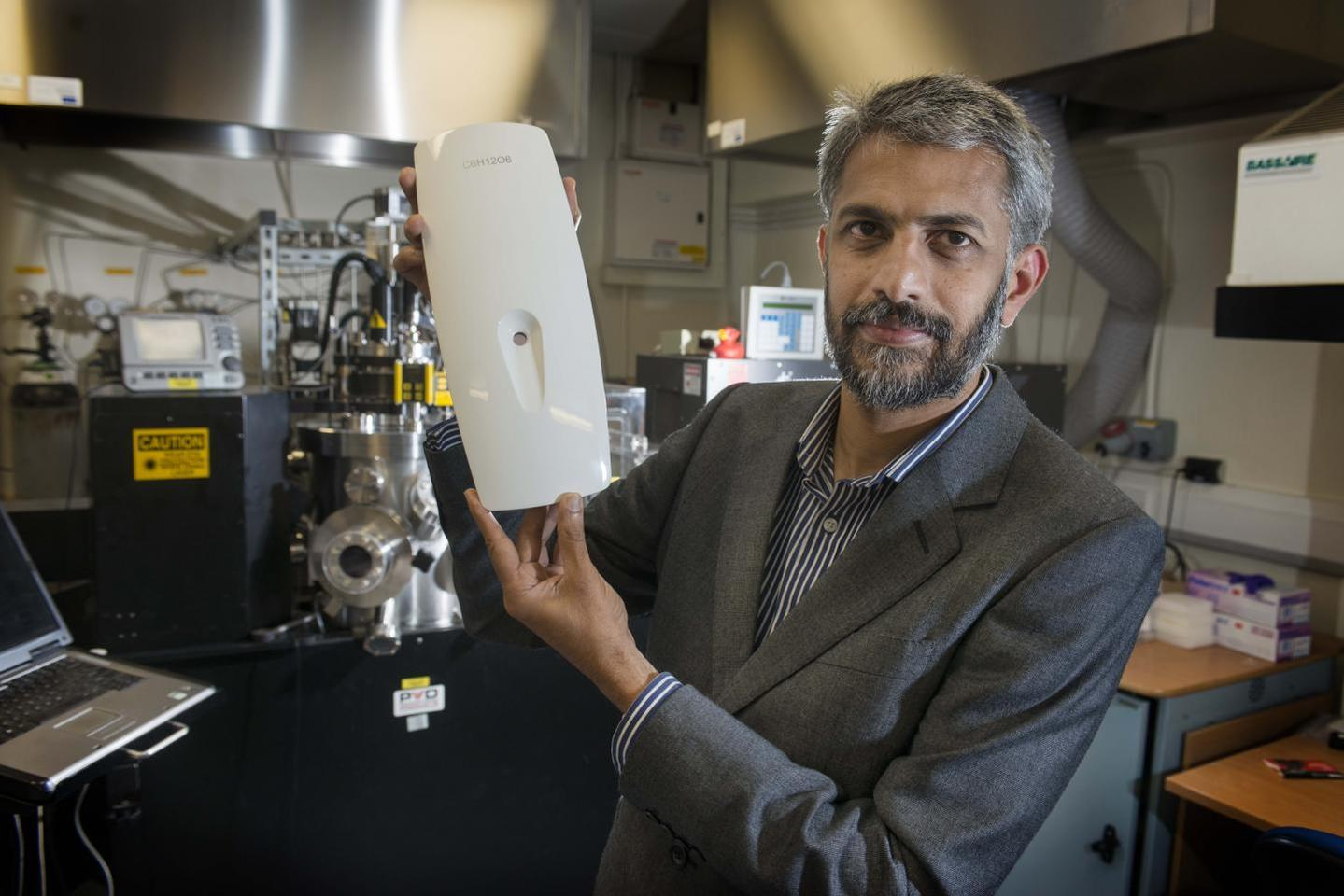 Prof. Gin Jose with the GlucoSense prototype