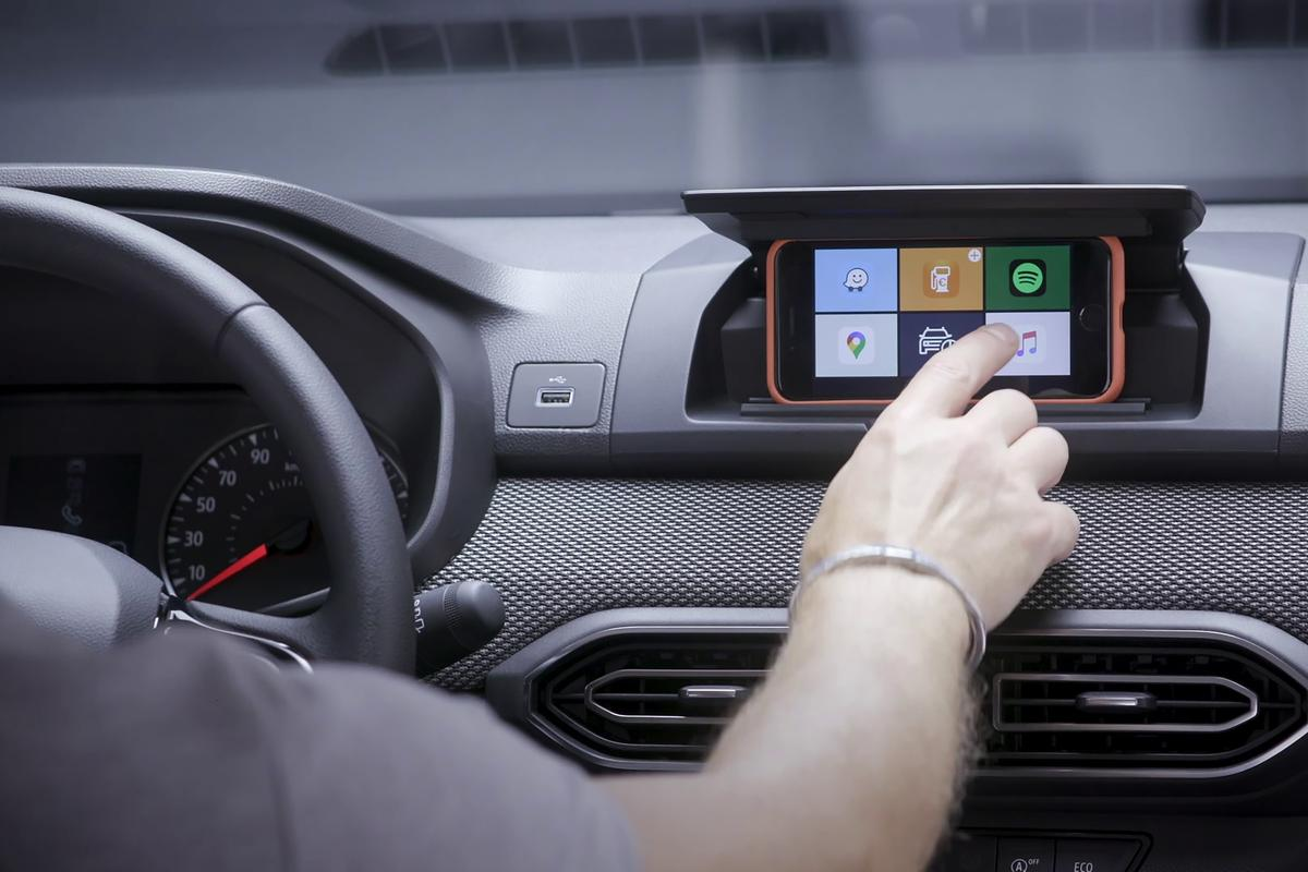 The Media Control system replaces a built-in infotainment screen with the driver's own smartphone