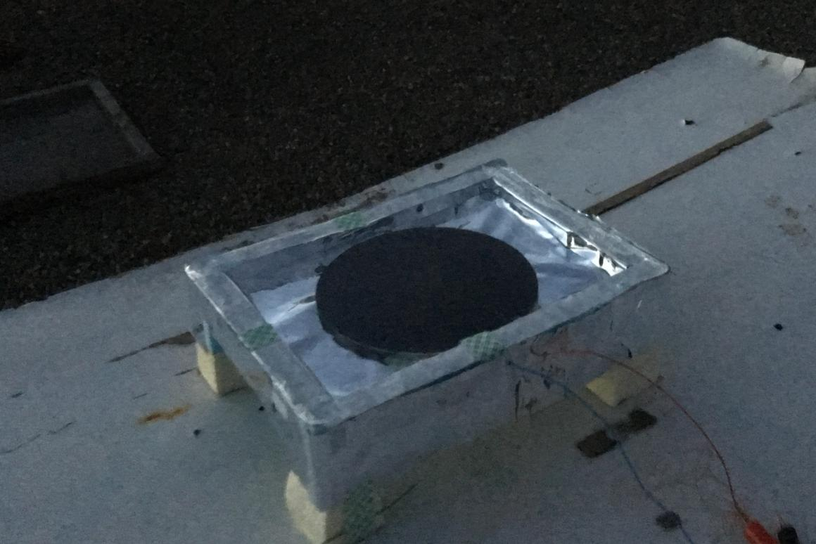 The thermoelectric generator uses a black aluminum disk to radiate heat into the atmosphere, and a polystyrene enclosure to keep the air inside warm.