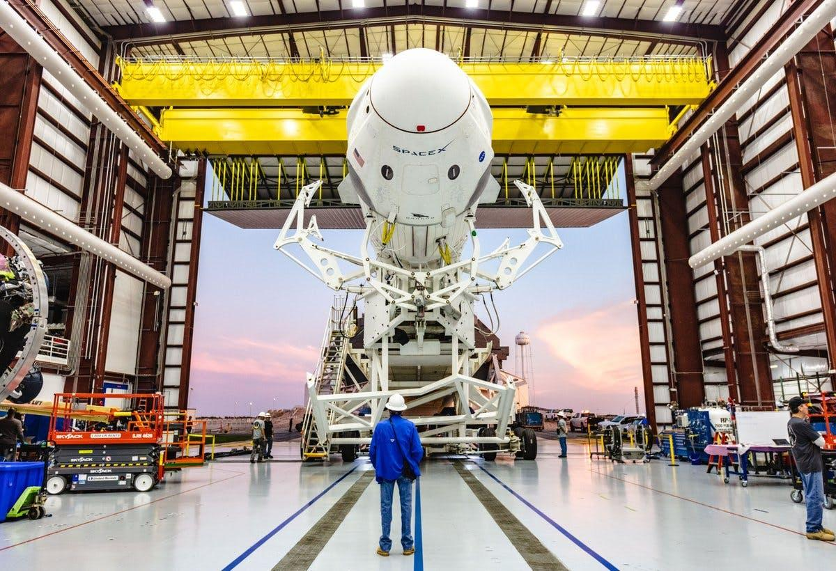 SpaceX's Crew Dragon and Falcon 9 booster in the hangar
