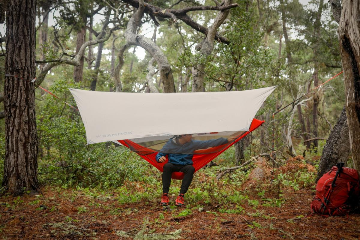 The Mantis UL hammock is secured to nearby trees with Python 10 ultralight straps