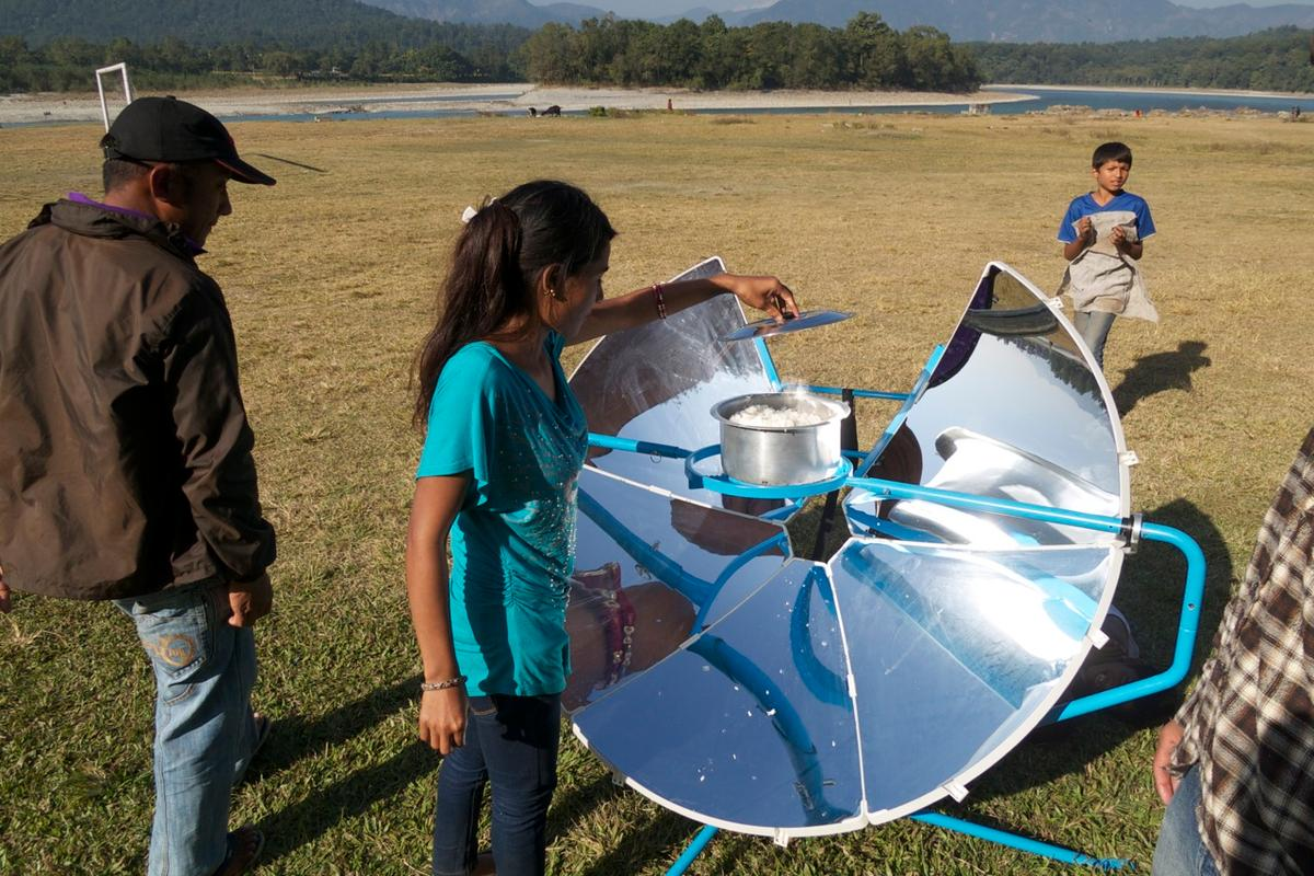 Cooking on the SolSource solar-powered grill