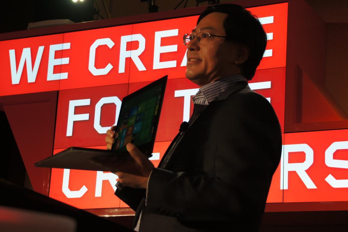 Lenovo CEO Yang Yuanqing shows off the IdeaPad Yoga at CES 2012 (Photo: Lenovo)