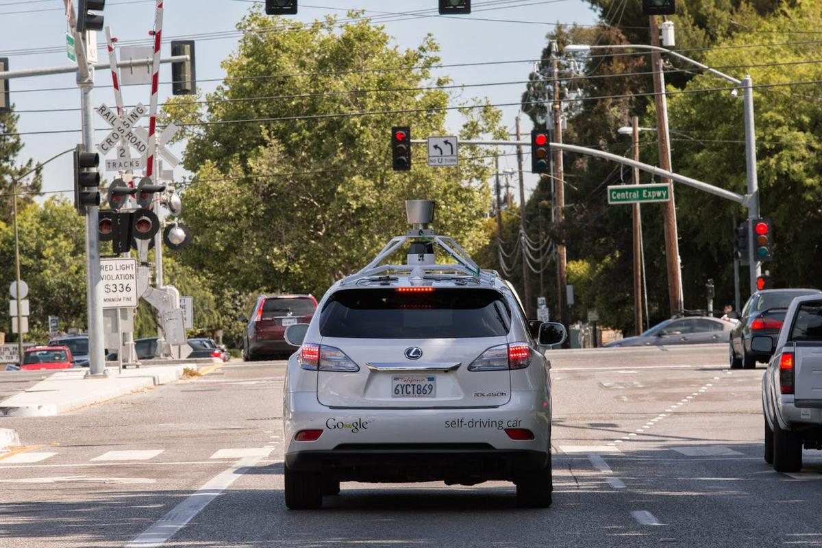 The Google Self-Driving Car prototype, based on a Lexis SUV, waits patiently at a traffic light