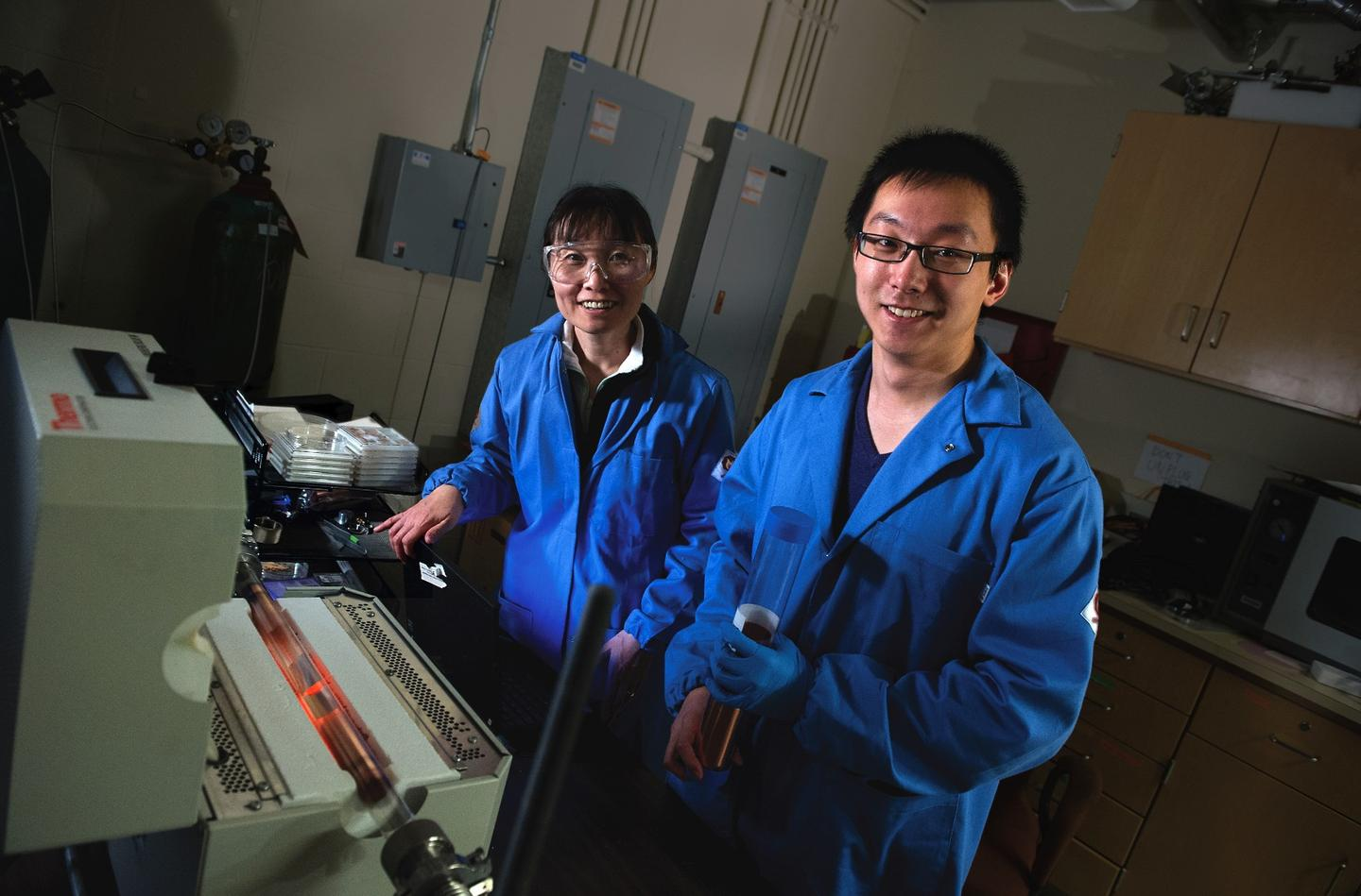 Two of the MIT researchers on the project, Jing Kong (left) and Yi Song (right)