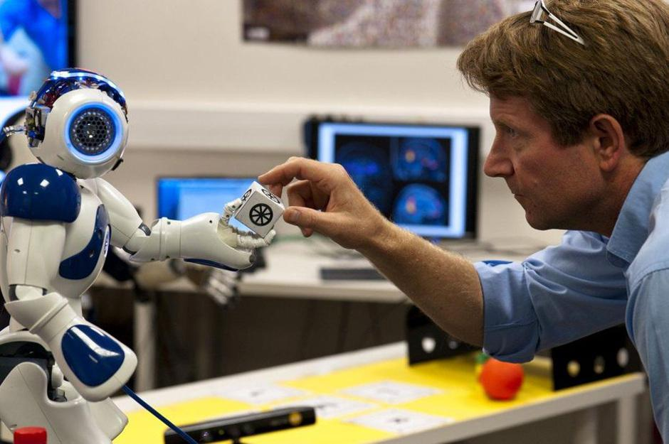 """Peter Ford Dominey and the robot Nao interact in order to store """"autobiographical memories"""" of how to recreate similar tasks, potentially in a situation aboard the ISS"""