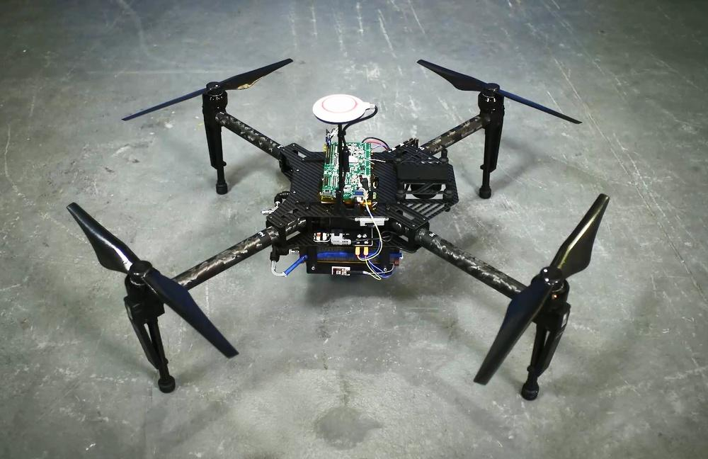 A quadcopter drone, equipped with a prototype of the range extender