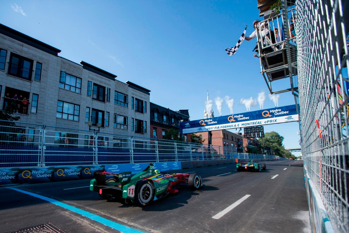 The two ABT Sportsline cars cross the line in Montreal