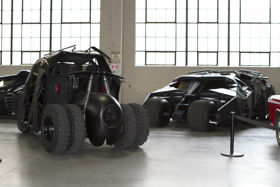 The Tumbler golf cart with a full-sized Tumbler in background